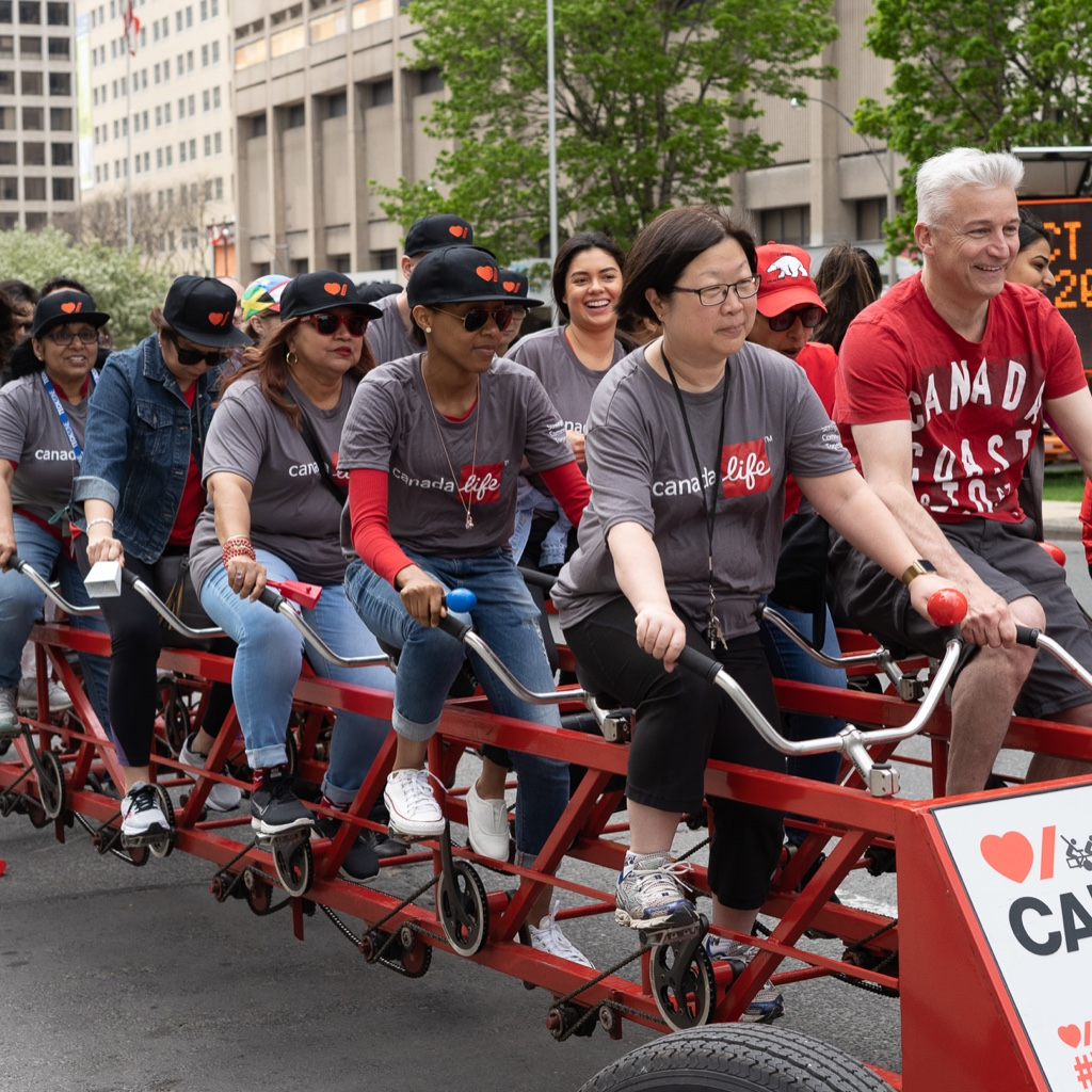 Group riding a big bike for charity event.
